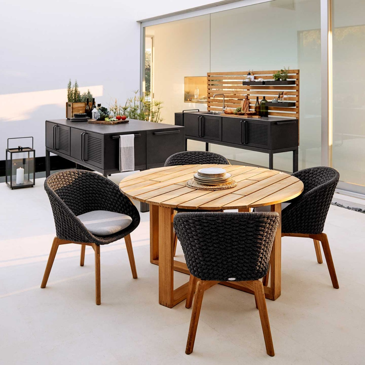 Endless small round dining table by Cane-line